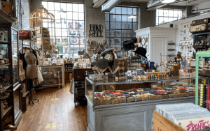 Inside the bird and bee vintage store with products on tables