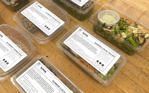 takeout containers from Nook's kitchen filled with food