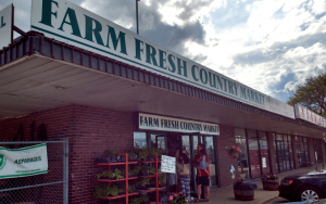 outside of the farm fresh country market red brick building with white and green sign   Top Local Destinations To Visit This Summer on The Dumfries Summer Trail