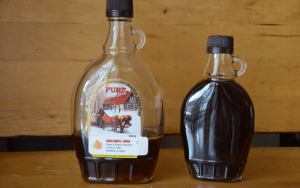 two bottles of maple syrup one with the label and one without   Top Local Destinations To Visit This Summer on The Dumfries Summer Trail