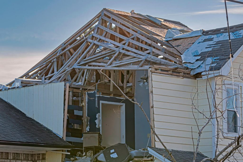 Home with roof and wall damage- Home Insurance Tips blog