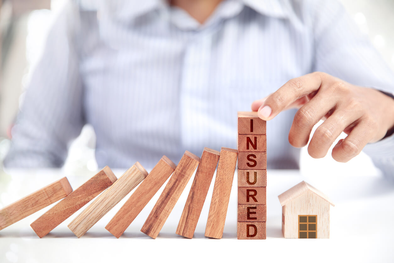 businessman and home model, insurance concept